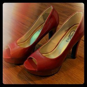 Candies red patent peep toe platforms
